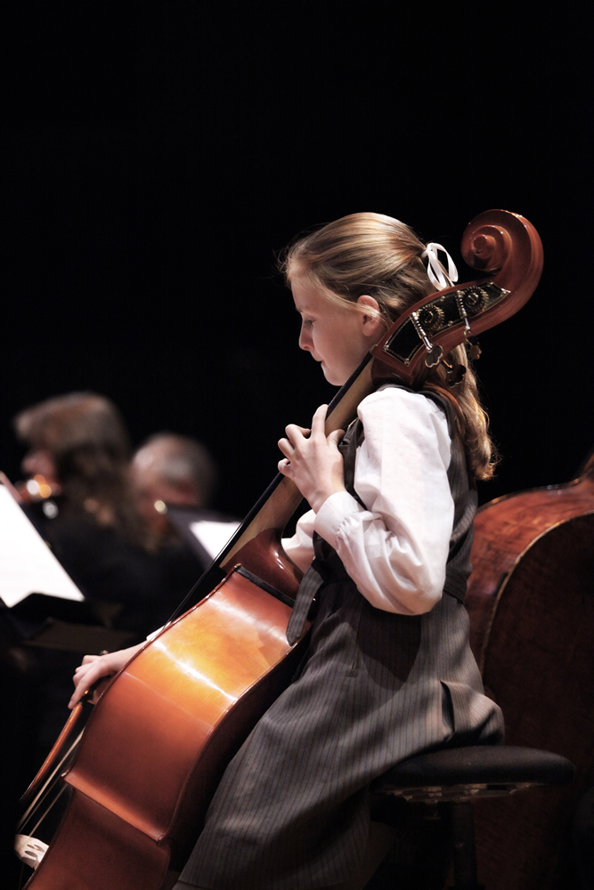Schoolgirl playing cello