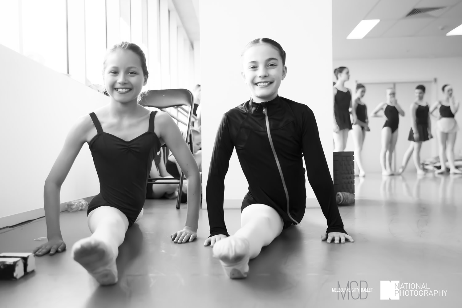 Two Youth Ballerinas warming up before class